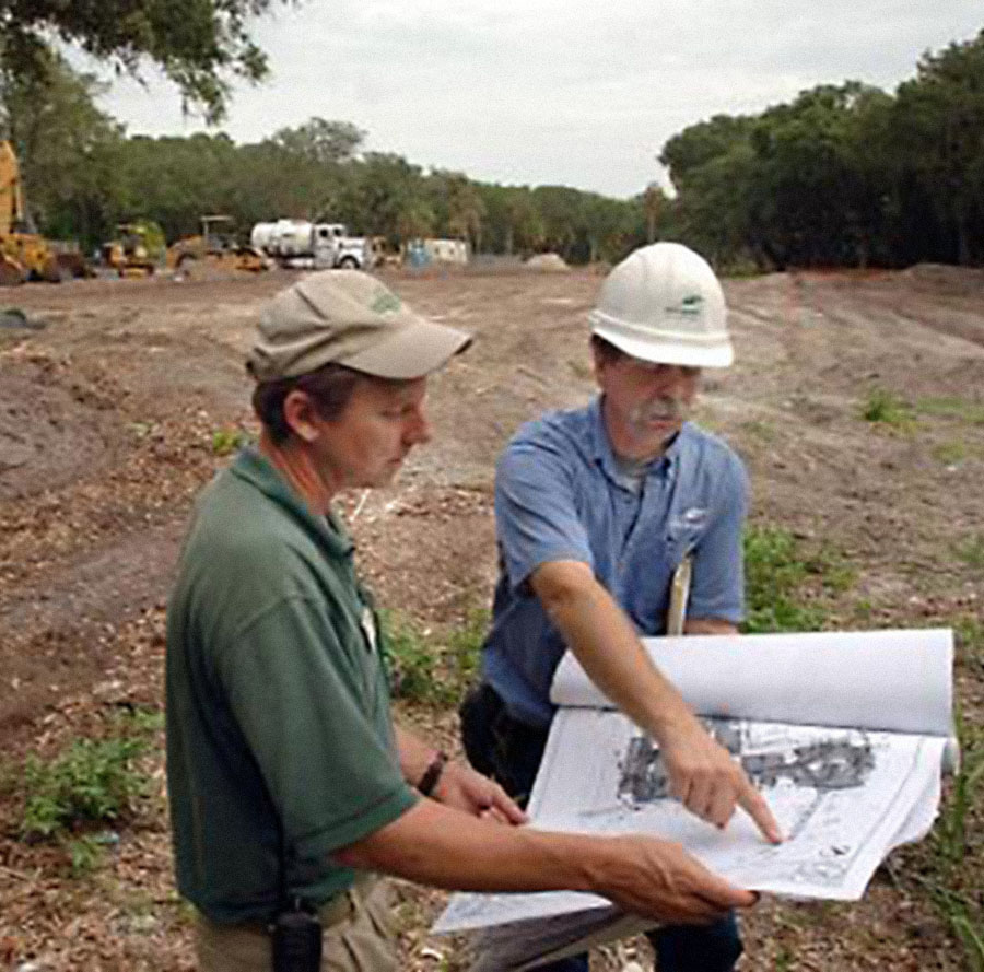 CHRIS VIOLA/The Times-Union-- 07/11/08 -- Jekyll Island Authority landscape supervisor Cliff Gawron (L) and arborist David Dechant (R) check the site of a new hotel development construction site on Jekyll Island , Georgia for the location of trees they want to preserve on the site, Friday, July 11, 2008. The development site is the former location of the Holiday Inn on the southern end of the island.   (The Florida Times-Union, Chris Viola)